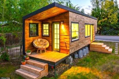Casa costruita con assi di pallet di legno a meno di € 10.000 ( $ 12.000 )
